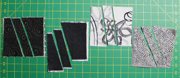 I picked two contrasting squares and cut them up to sew tham back together, making two rectangles.