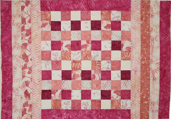 Pink and cream strips used to make baby size quilt.